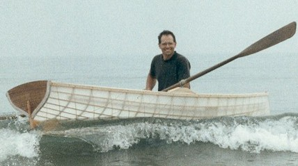 Roger Noble's Classic 12 rowing in the surf